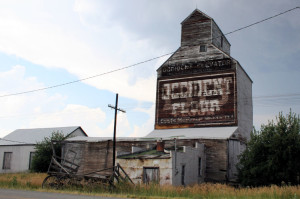 Wood grain elevator and old wooden wagon, Sweetgrass, Montana