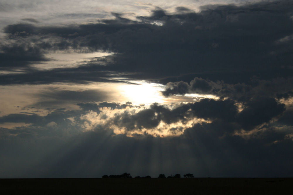 Evening rays shine on a farm, Kansas horizon